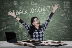 Excited female student in the classroom Royalty Free Stock Photo