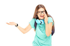 Excited female student gesturing. Isolated on white background Royalty Free Stock Images