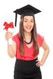 Excited female student holding a diploma. Isolated on white background Stock Images