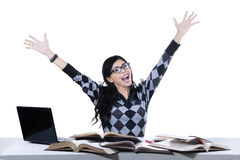Excited female student isolated. Excited female college student studying isolated on white background Stock Photography