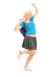 Excited female student with raised hands. Full length portrait of an excited female student with raised hands  on white background Stock Photos