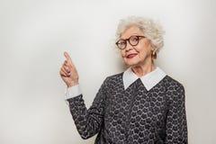 Excited female teacher presenting something interesting Royalty Free Stock Photo