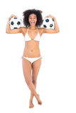 Excited fit girl in white bikini holding football Royalty Free Stock Image