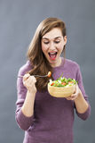 Excited fit and healthy lady ready to eat light salad Royalty Free Stock Images