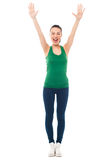 Excited fitness girl raising her hands Stock Image
