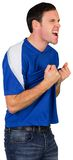 Excited football fan in blue Stock Images