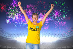 Excited football fan in brasil tshirt Stock Images