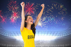 Excited football fan in brasil tshirt Stock Photos