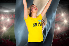 Excited football fan in brasil tshirt holding argentina flag Stock Images