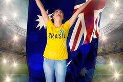Excited football fan in brasil tshirt holding australia flag Stock Photo