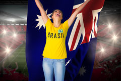 Excited football fan in brasil tshirt holding australia flag Stock Photo
