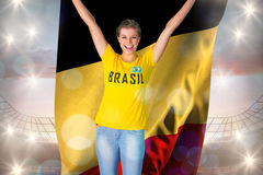 Excited football fan in brasil tshirt holding belgium flag Stock Photos