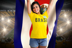 Excited football fan in brasil tshirt holding costa rica flag Stock Photo