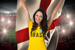 Excited football fan in brasil tshirt holding england flag Royalty Free Stock Photos