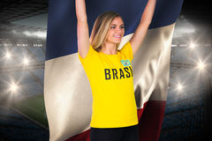 Excited football fan in brasil tshirt holding france flag Stock Photography