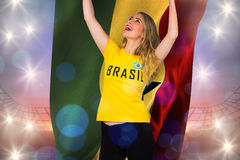 Excited football fan in brasil tshirt holding ghana flag Royalty Free Stock Images