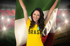 Excited football fan in brasil tshirt holding italy flag Royalty Free Stock Photography