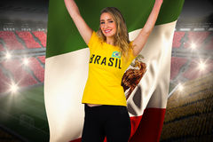 Excited football fan in brasil tshirt holding mexico flag Stock Photo