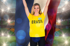Excited football fan in brasil tshirt holding netherlands flag Stock Photo