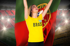 Excited football fan in brasil tshirt holding portugal flag Stock Image