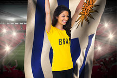 Excited football fan in brasil tshirt holding uruguay flag Royalty Free Stock Images