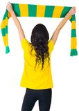 Excited football fan in brasil tshirt Royalty Free Stock Image