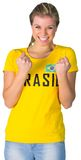 Excited football fan in brasil tshirt Royalty Free Stock Photography