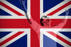 Excited football fan cheering. Against great britain national flag Royalty Free Stock Image