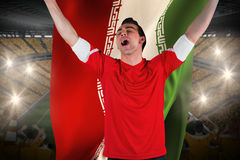 Excited football fan cheering holding iran flag Stock Images