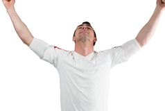 Excited football fan cheering Stock Photos