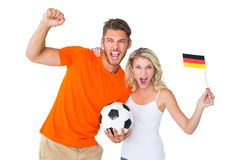 Excited football fan couple cheering at camera Royalty Free Stock Photo