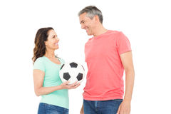 Excited football fan couple cheering at camera Royalty Free Stock Photos