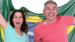 Excited football fan couple holding brazil flag stock video footage