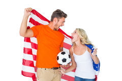 Excited football fan couple holding usa flag Stock Photography