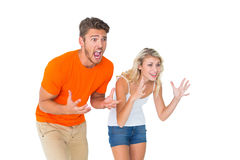 Excited football fan couple looking nervous Royalty Free Stock Photography