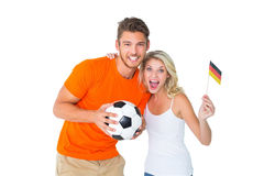 Excited football fan couple smiling at camera Royalty Free Stock Photography