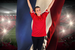 Excited football fan in red cheering holding france flag Royalty Free Stock Photography