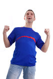 Excited football fan watching sport Royalty Free Stock Photo