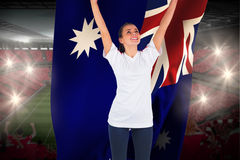 Excited football fan in white cheering holding australia flag Stock Photography