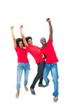 Excited football fans in red cheering Stock Image