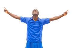 Excited football player in blue cheering Royalty Free Stock Photos