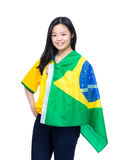 Excited football supporter with Brazil flag. Isolated on white Stock Photo