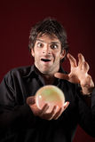 Excited Fortuneteller. Gazes over a crystal ball Stock Photography