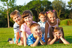 Excited friends. Six excited preschool friends in the backyard Stock Photography