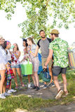 Excited friends arriving at music festival Royalty Free Stock Photos