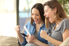 Excited friends checking content on line Royalty Free Stock Image