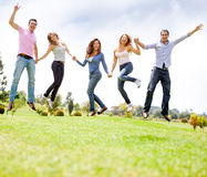 Excited friends jumping Stock Photo