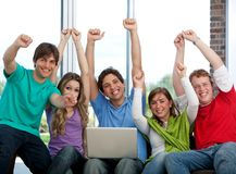 Excited friends with a laptop Royalty Free Stock Photography