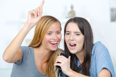 Excited friends listening music and singing stock photos