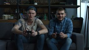 Excited friends playing video games at home stock video footage